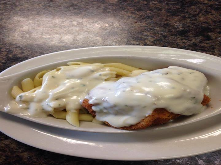 Penne pasta chicken topped with creamy alfredo sauce