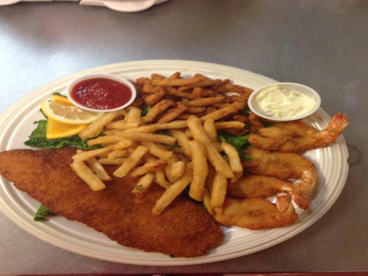 Seafood combination platter with One crab cake, flounder, clams, shrimp.