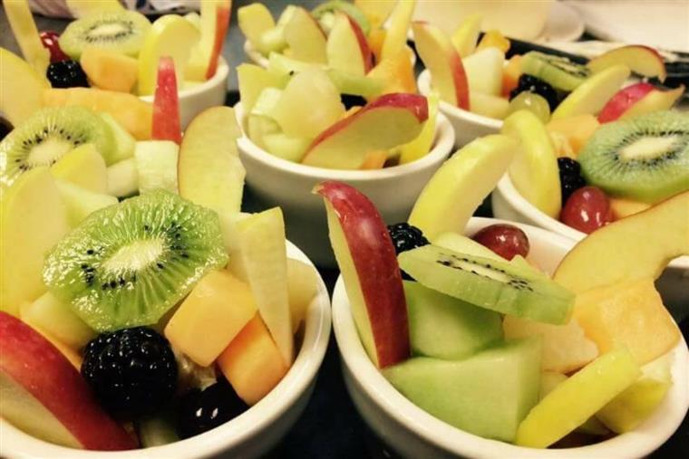 fruit cups with cantaloupe, pineapple, apples, honeydew melon, blackberries, grapes and kiwi