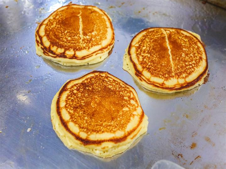 three pancakes on the griddle