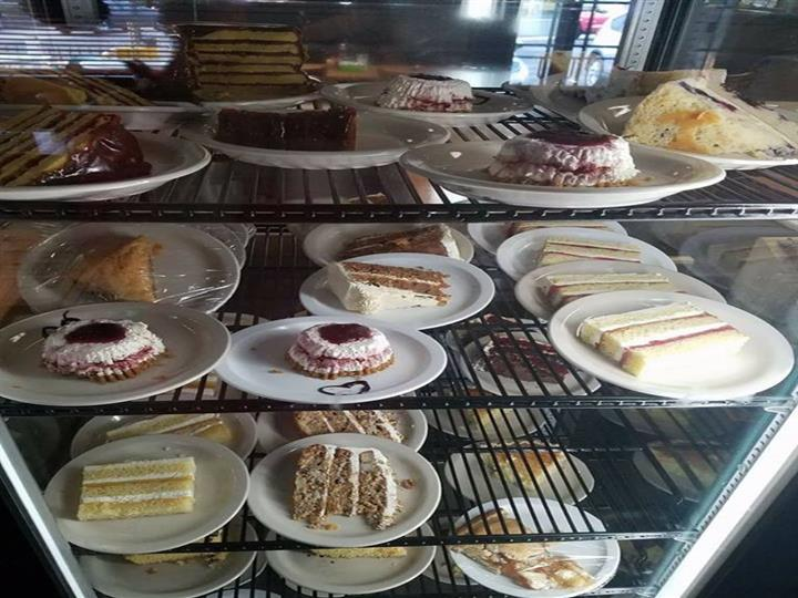 assortment of bakery goods in a glass case