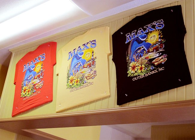 t-shirts hanging on the wall