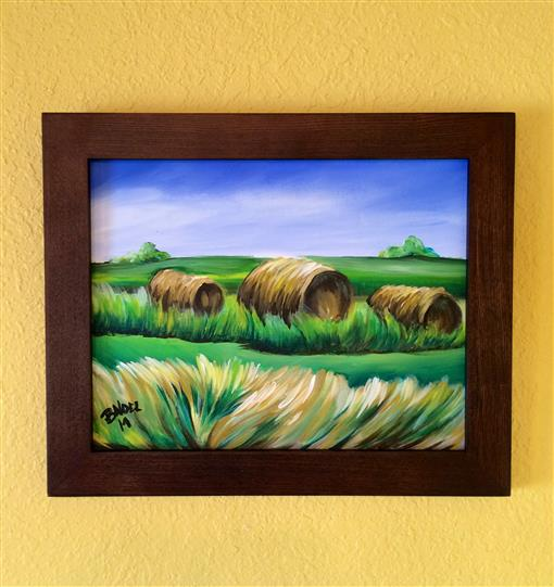 Local Art with hay bales on a field