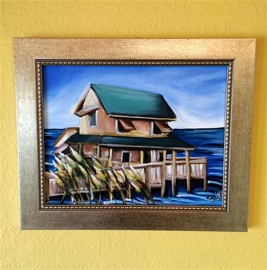 Local art of a little house on the water