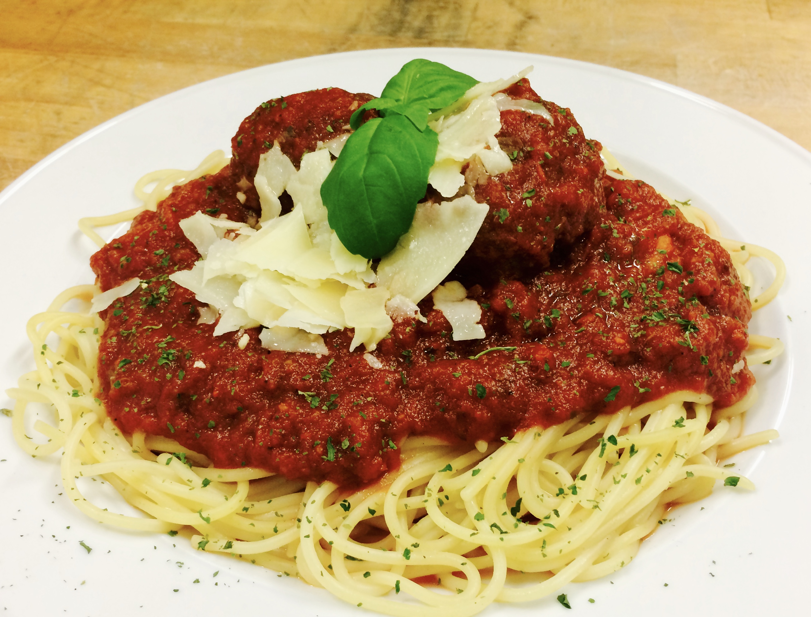 Spaghetti with red sauce on top