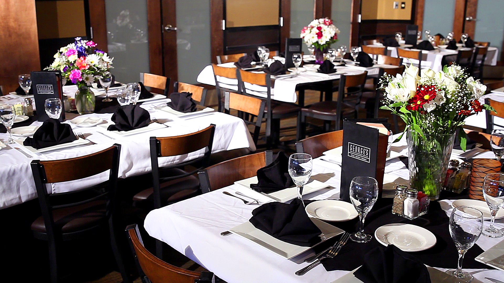 the banquet room with tables set