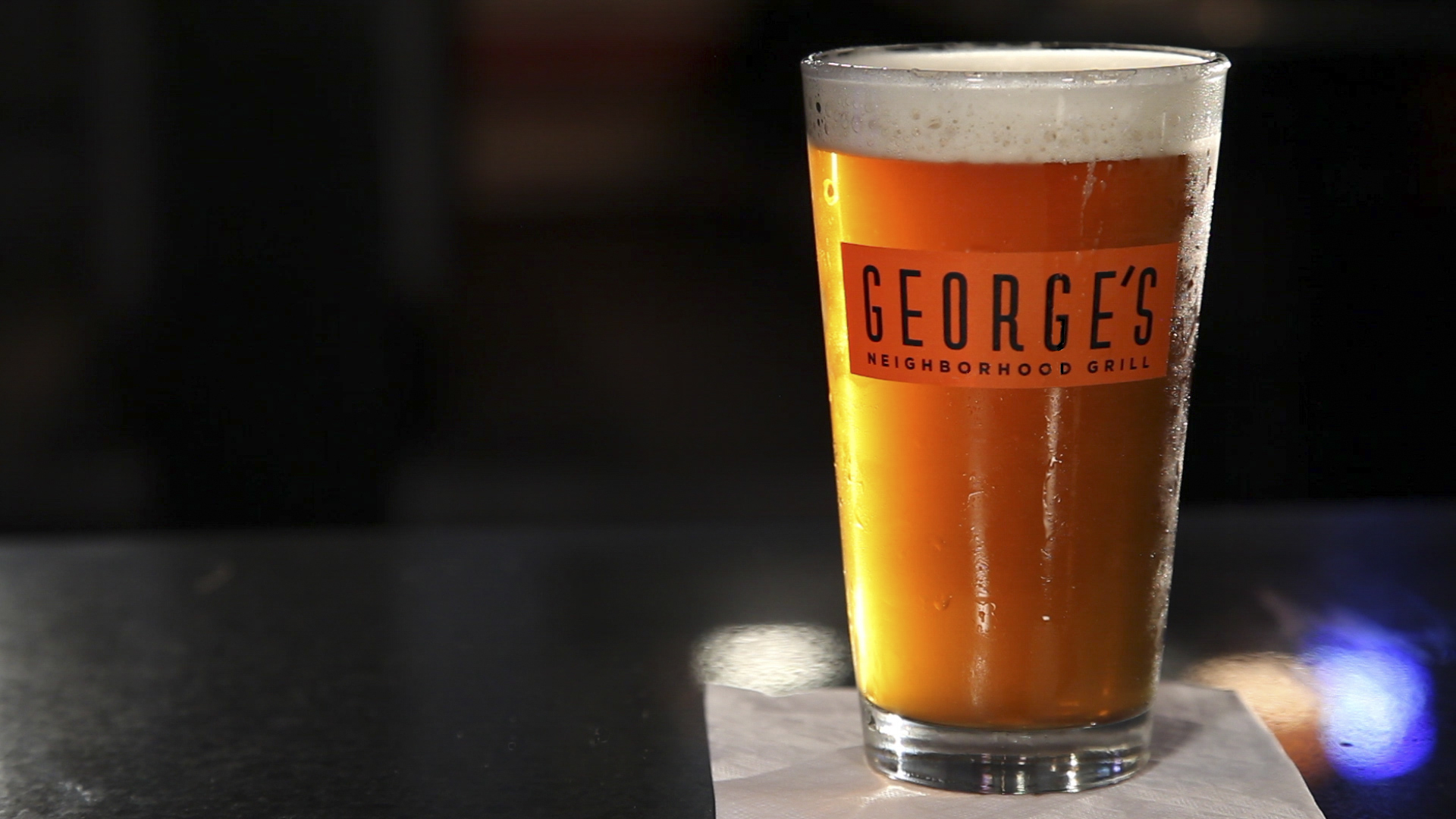 a George's Neighboorhood Grill glass with beer inside