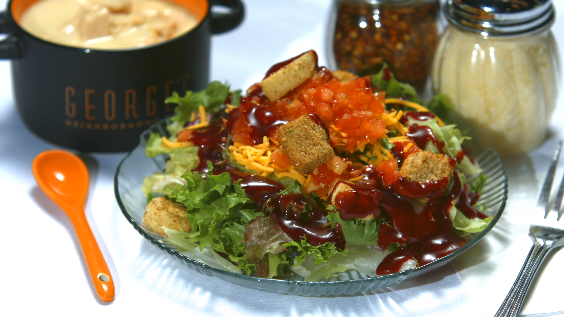 Salad with cheese, croutons and chopped tomato with a dressing on top