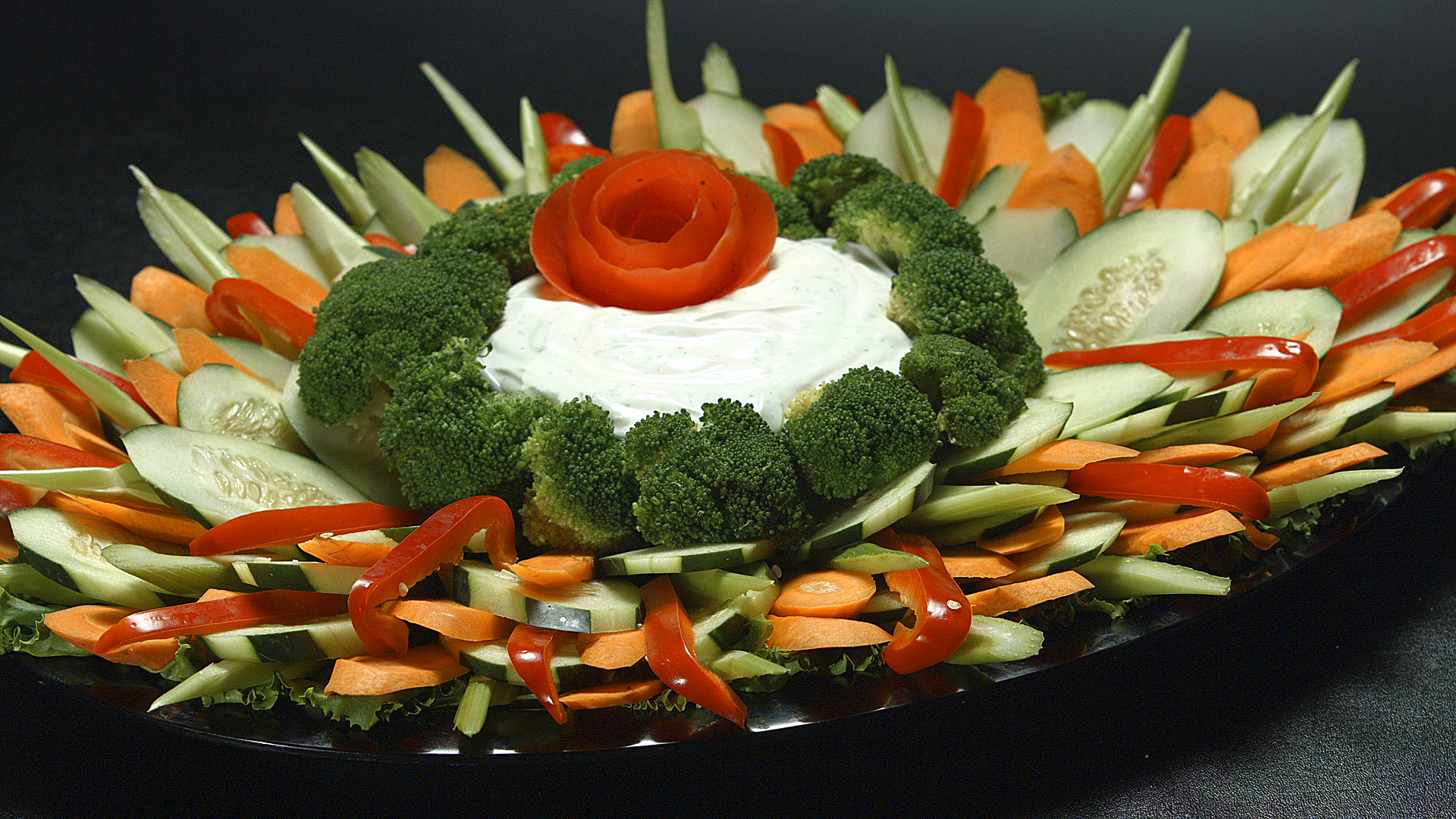 Veggie platter with dip in the middle