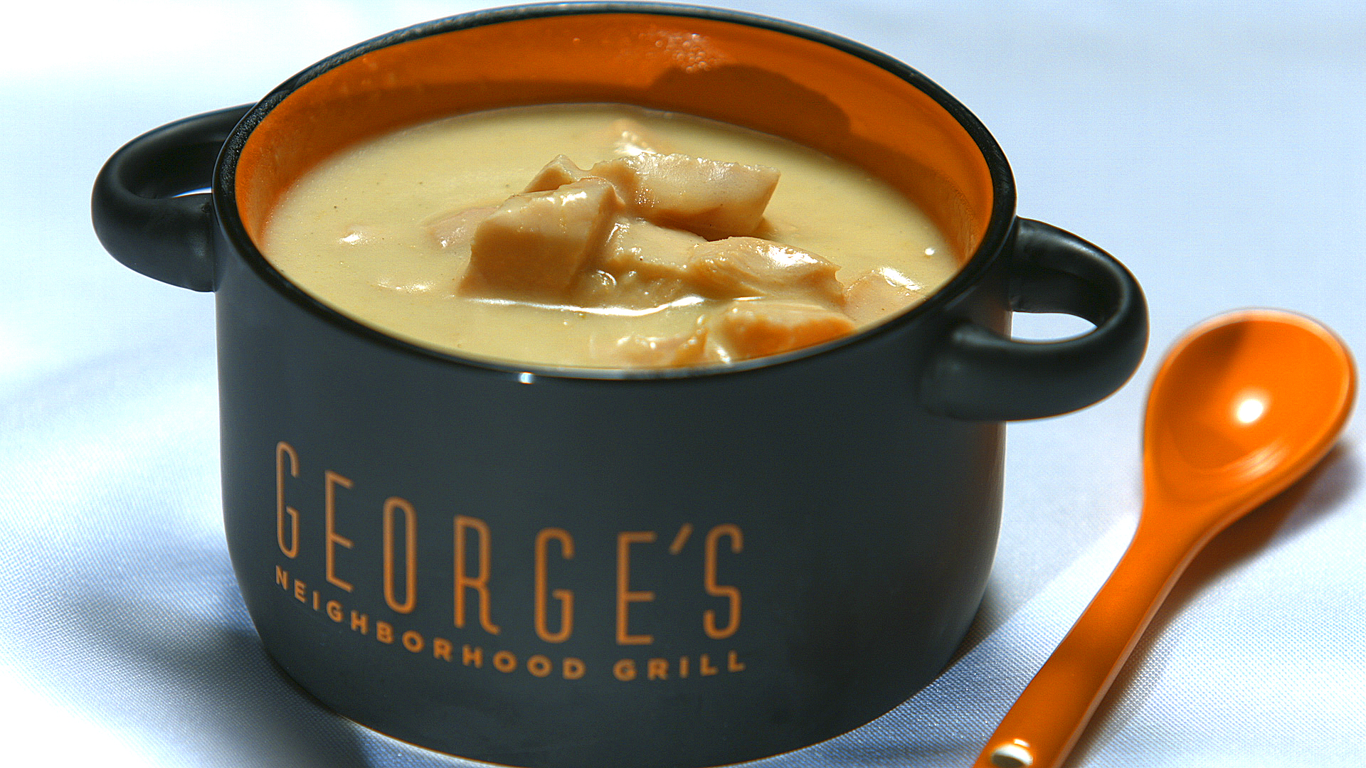 George's grill coffee cup filled with soup