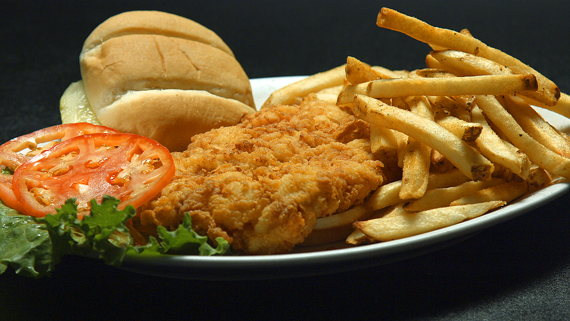 Fried chicken with fries and bread on the side