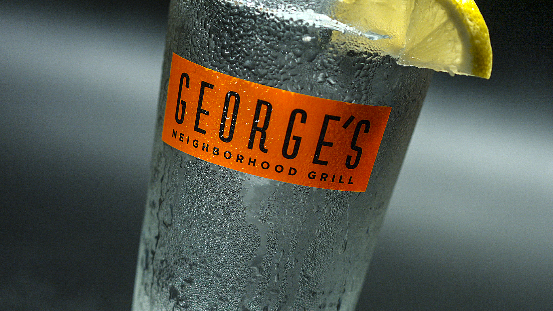 George's Neighboorhood Grill cup with a lemon wedge on the side