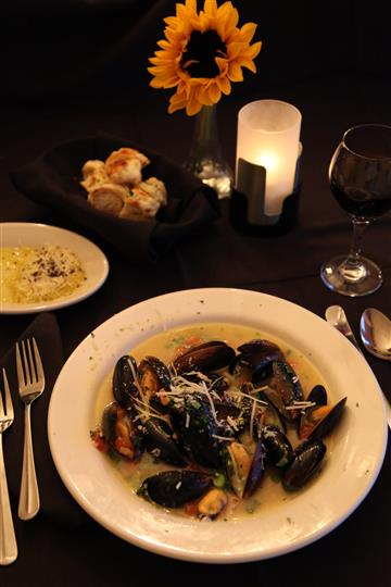 bowl of mussels with sauce