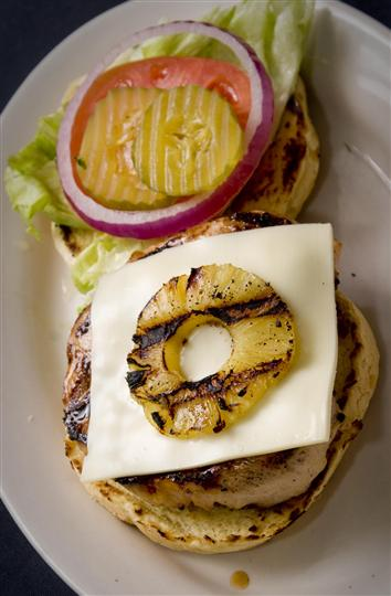 Cheese burger with a grilled pineapple