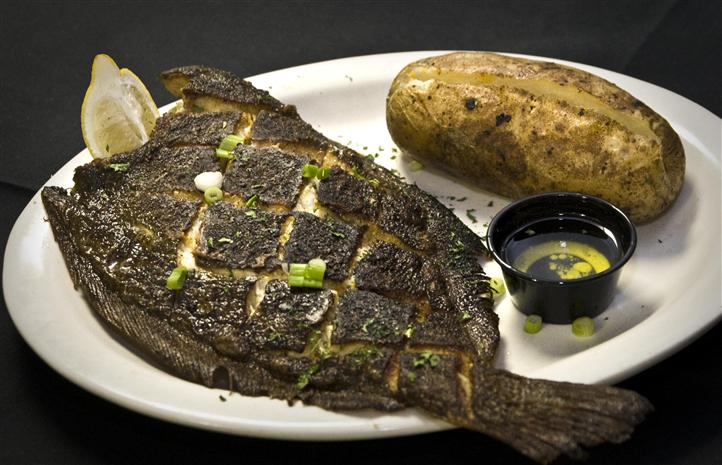 Grilled fish with a baked potato