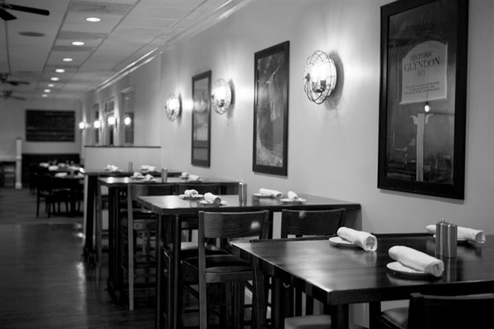 black and white photo of tables in glyndon grill