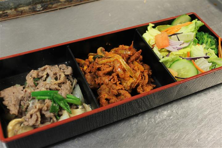 bento box with assorted korean food