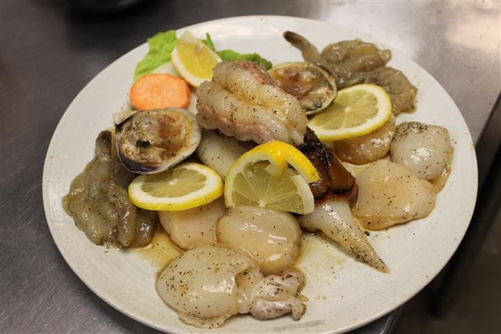 seafood entree dish with lemon slices