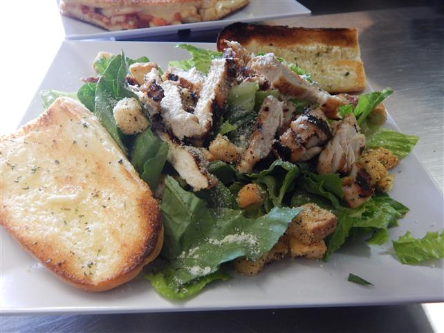 chicken salad with croutons, cheese and garlic bread