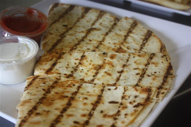 grilled quesadilla with sauce and salsa on the side