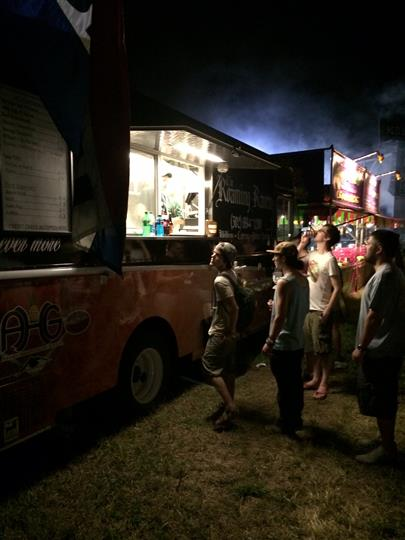line of customers waiting to order their food at the roaming raven food truck