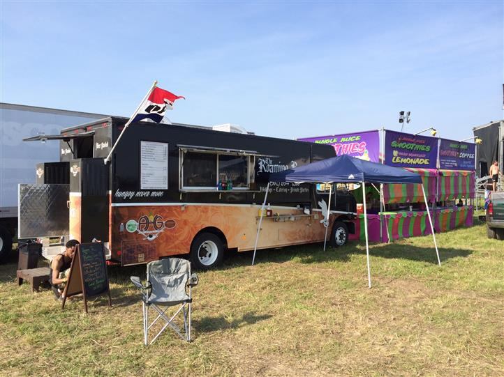 the roaming raven food truck parked at an outdoor event