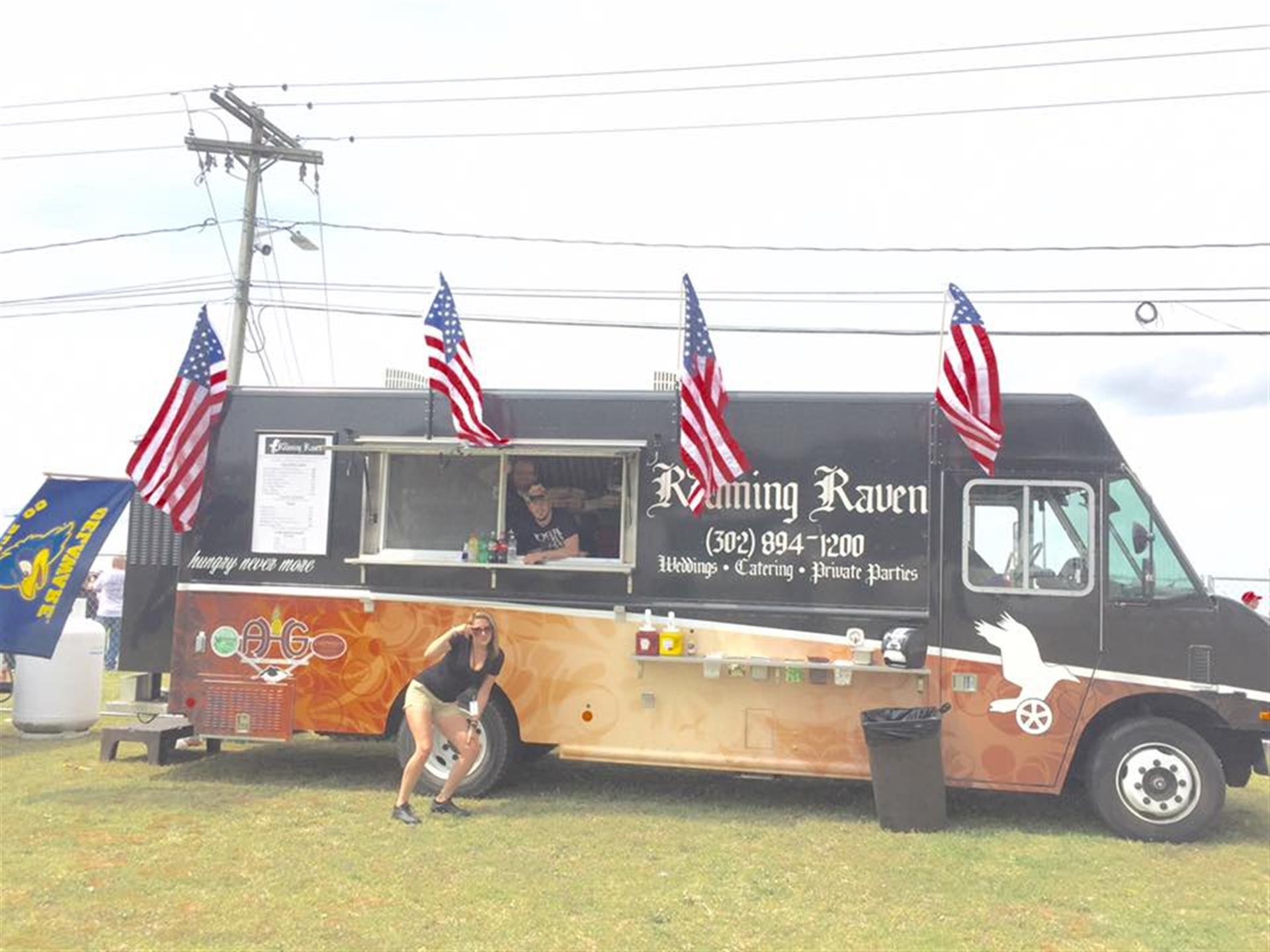 The roaming raven truck outside on the grass