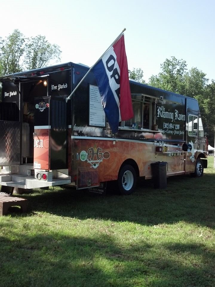 the roaming raven food truck with a flag hanging that says open