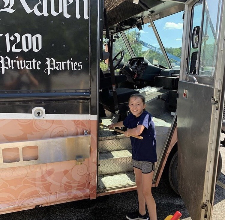 little girl in front of the Roaming Raven truck