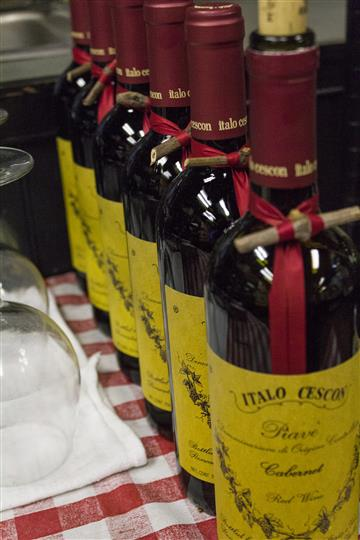 Italo Cescos wine bottles lined up on table