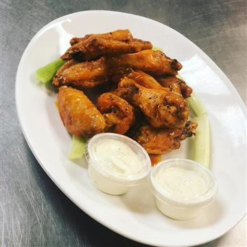 Bone-in wings with a side of ranch