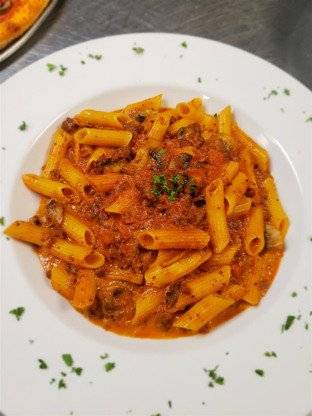 Rigatoni della nonna with meat sauce in a bowl
