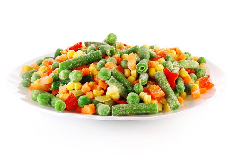 bowl of frozen veggies, such as peas, corn, carrots, and green beans