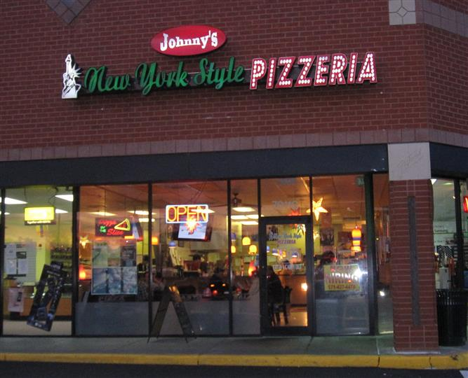 exterior brick building to johnny's new york style pizzeria & restaurant