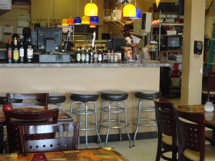 interior counter area with stools for customers to use while they eat at the counter
