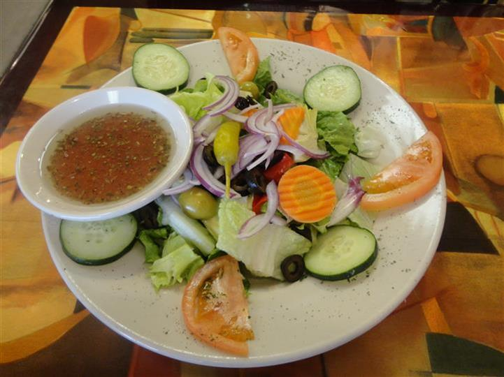 salad with cucumber, tomatoes, carrots, onions and peppers