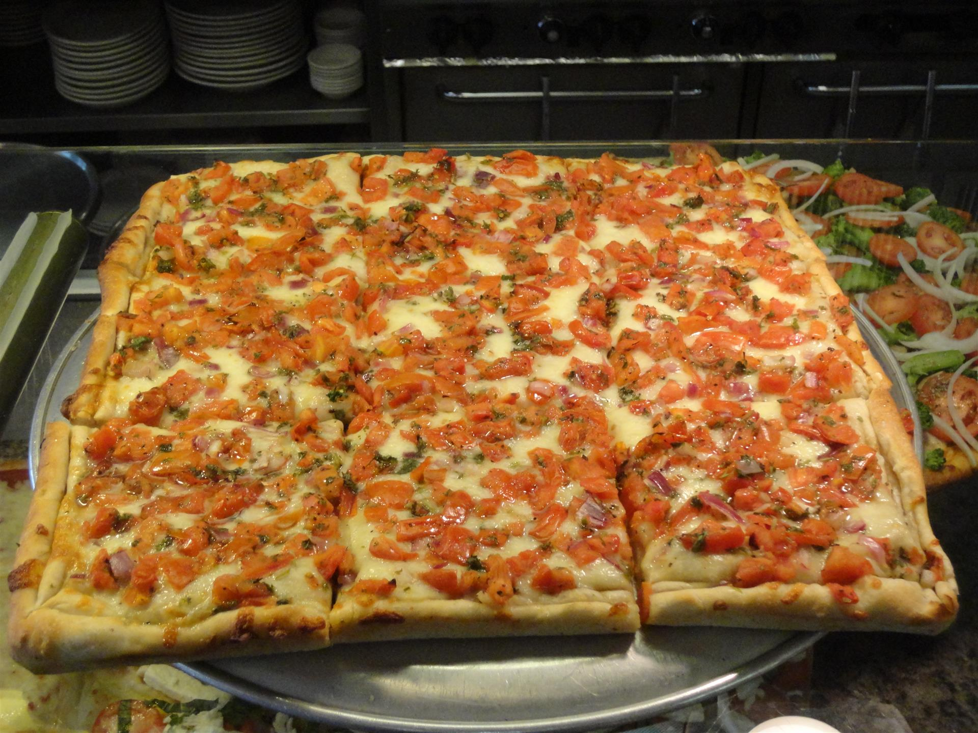 Sicilian pizza with toppings