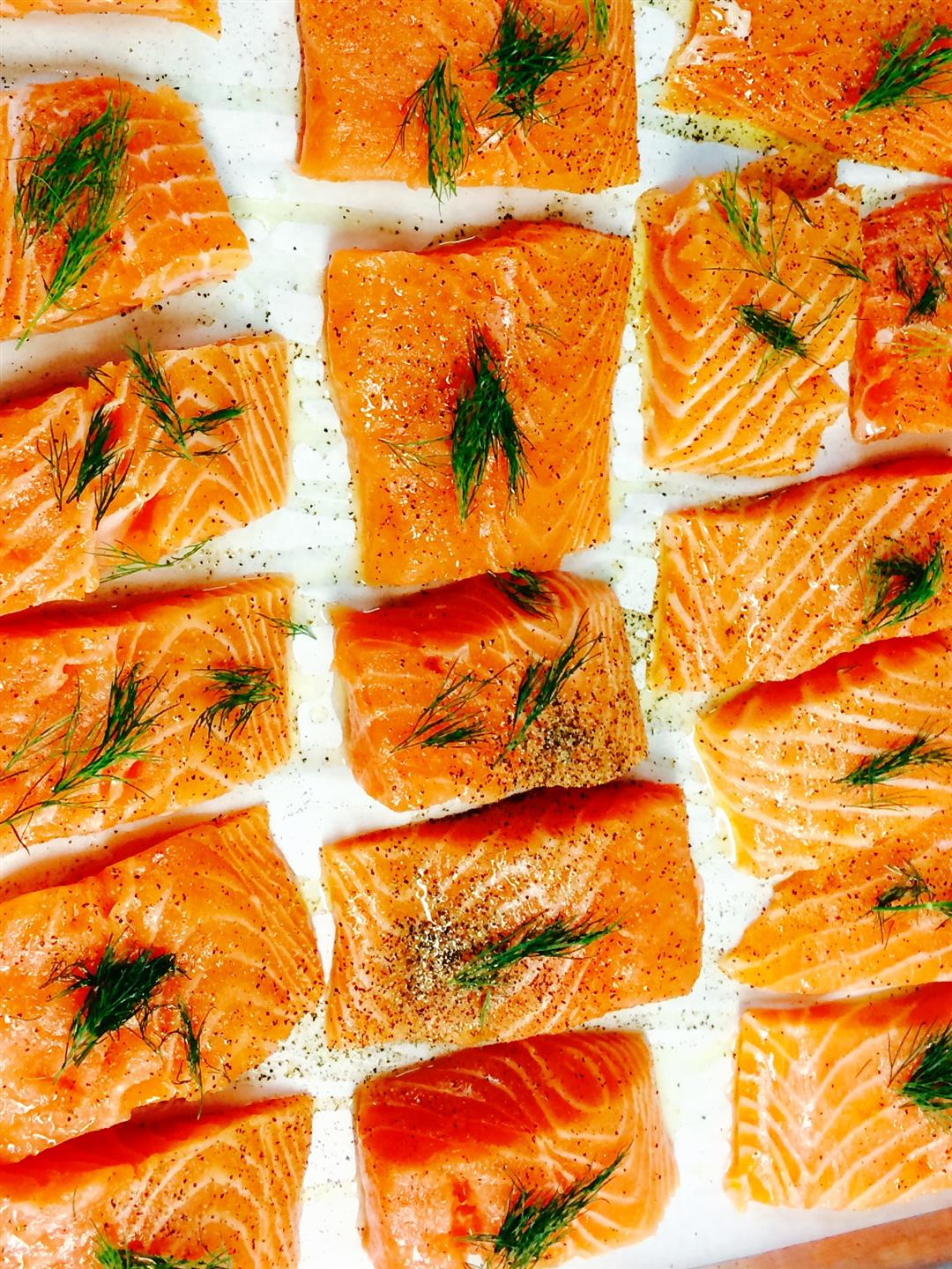 catering display of baked salmon topped with dill