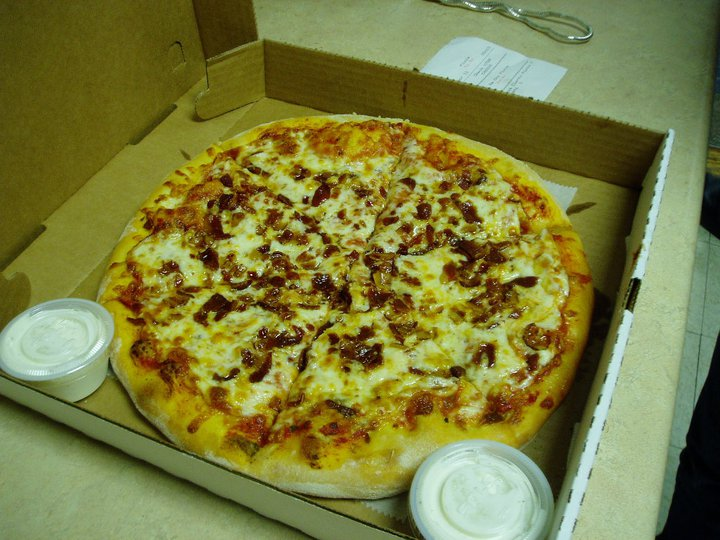 pizza in a box topped with sausage and cheese. Served with ranch dressing.
