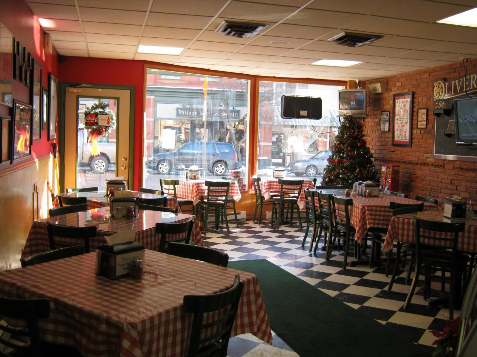 interior dining area for oliveri's pizzeria with tables and chairs
