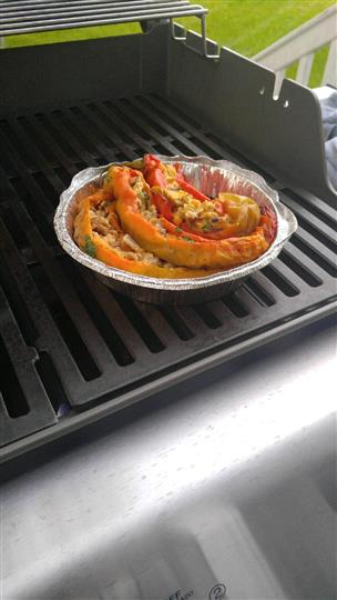 baked stuffed chilis with meat and cheese on a grill