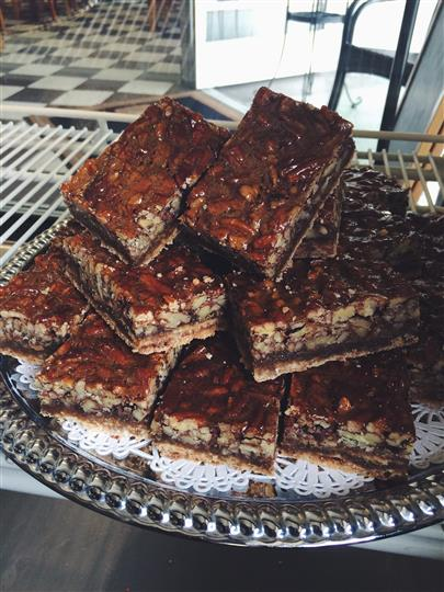 Pecan bars stacked on serving dish