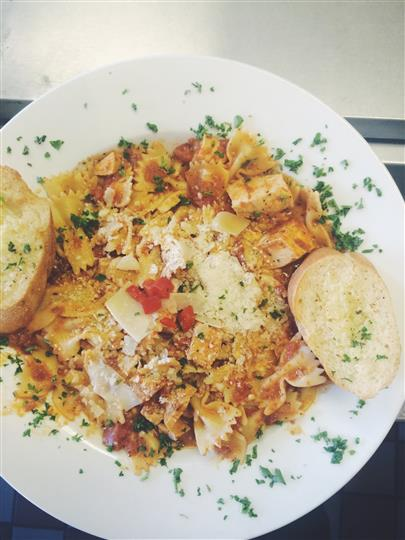 "Chicken farfalle. Bowtie pasta with roasted chicken in a ""pink"" sauce; tomato and a touch of cream."