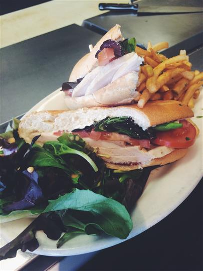 Grilled Chicken. Roasted red pepper, provolone cheese, baby greens and lemon pesto aioli served on a brioche roll.