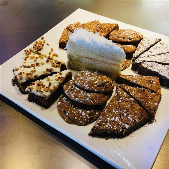 Assorted desserts on dish.