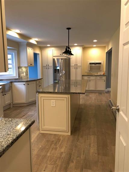 view of someones kitchen with light fixtures