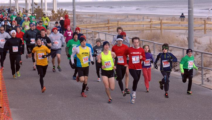 People doing the polar bear marathon alongside the shore