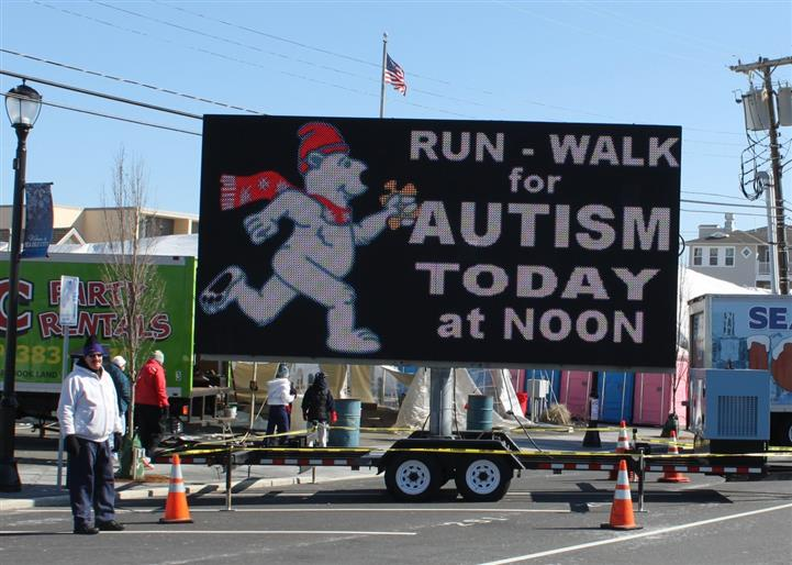 Polar Bear Run-walk for autism today at noon sign on road.
