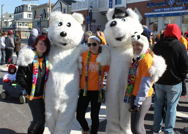 People taking a photo with people in polar bear costumes