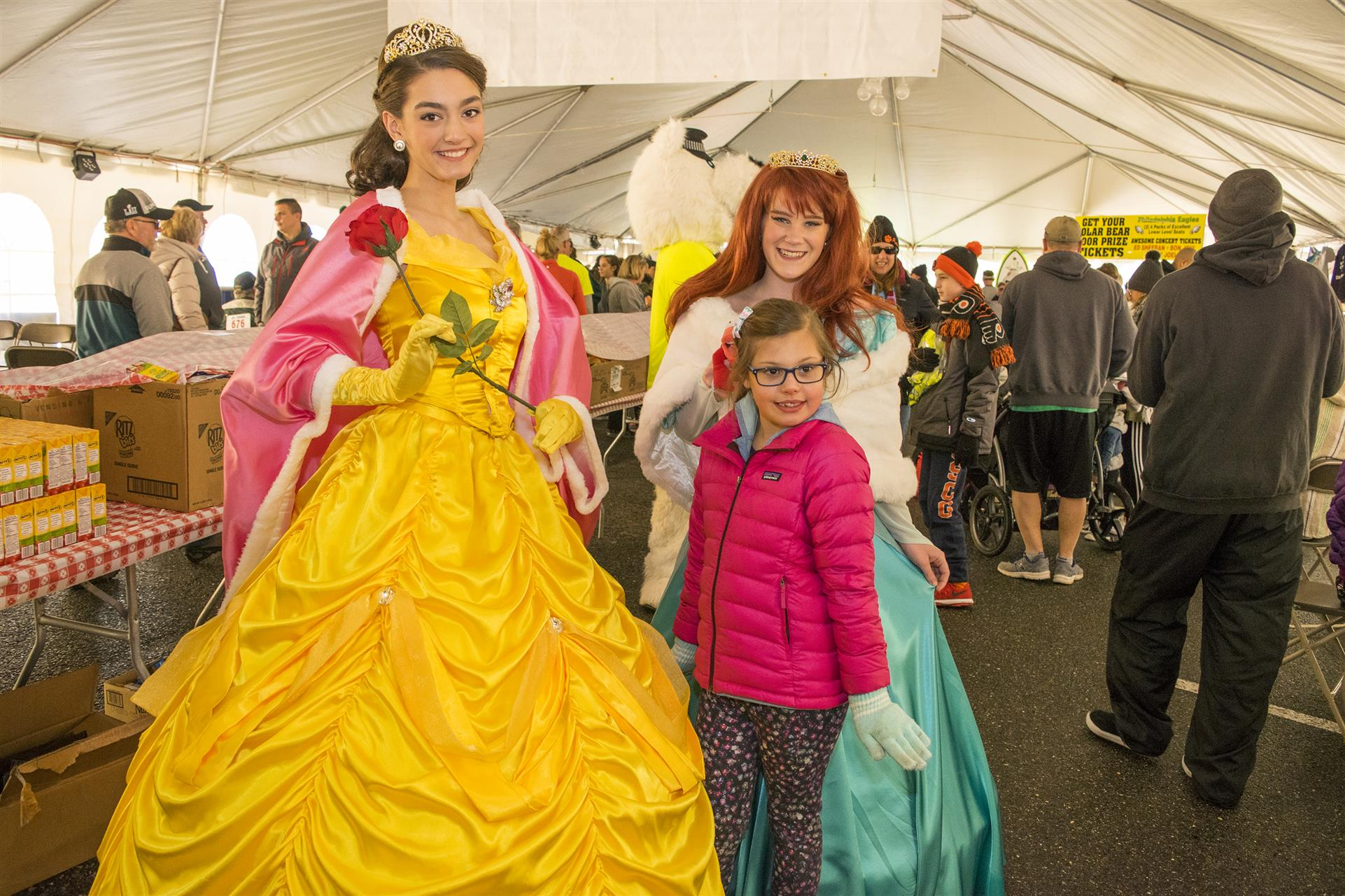 someone dressed up as belle from beauty and the beast with a kid